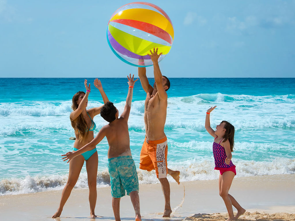 family playing on the beaches of the Riviera Maya