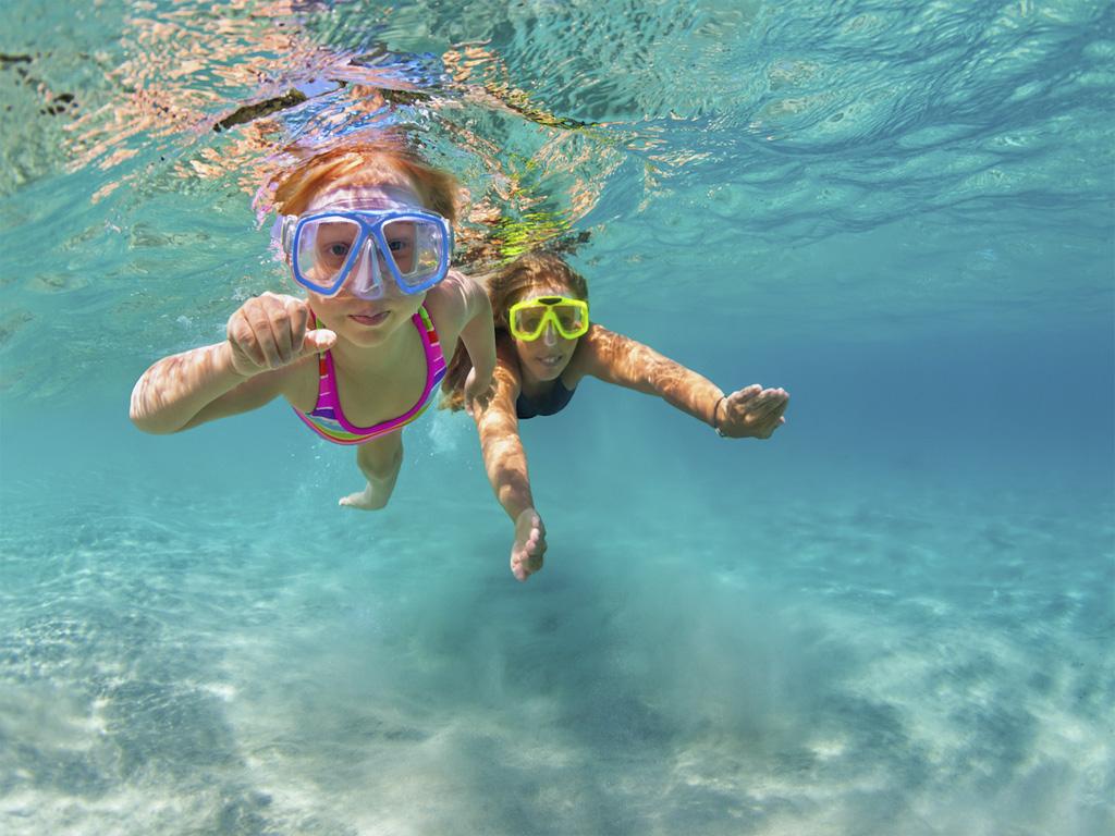 children swimming beach